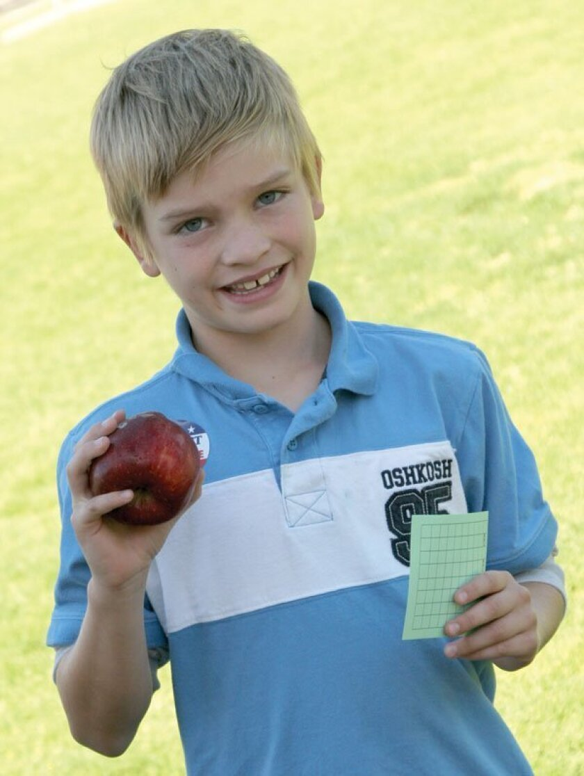 Jacob Gaines (with apple and sticker that says 'I Elect to be Drug Free'