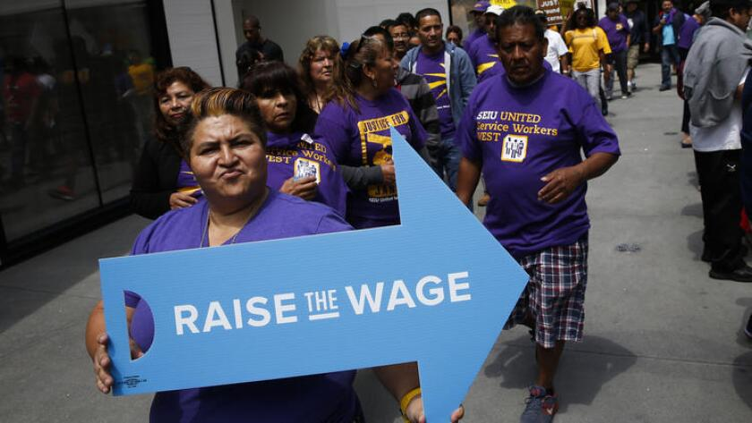 SEIU workers march in downtown Los Angeles earlier this year for a higher minimum wage.