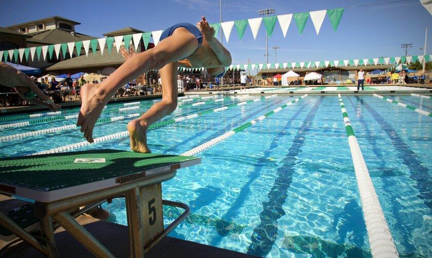 Kids compete at the Y Champs swim meet held at Brian Bent Memorial Aquatics Complex in Coronado.