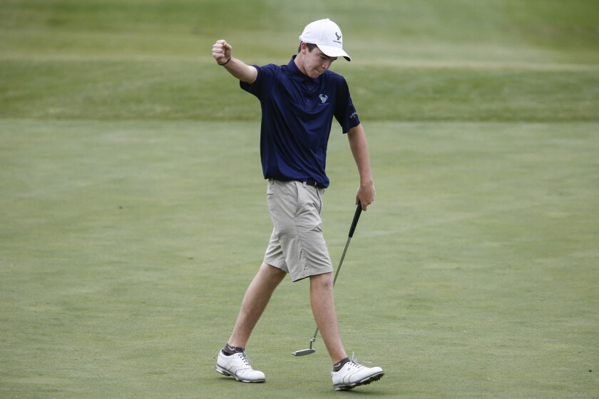 La Costa Canyon's Luke Potter reacts after sinking putt in 2019 CIF San Diego Section boys golf championship.