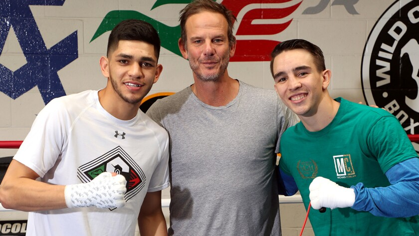 Director Peter Berg is flanked by fighters Alex Saucedo, left, and Michael Conlan during a recent media session at Wild Card West Boxing Club in Santa Monica.