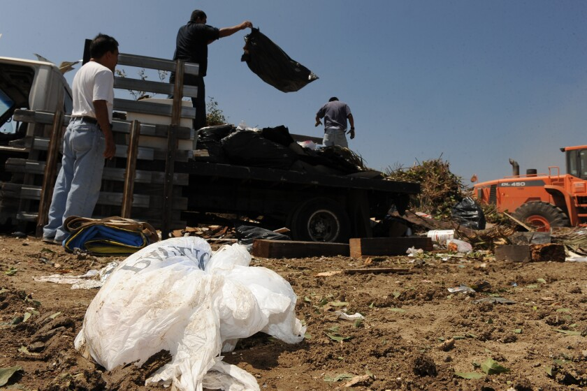 Work crews dump trash at the Scholl Canyon landfill in Los Angeles.
