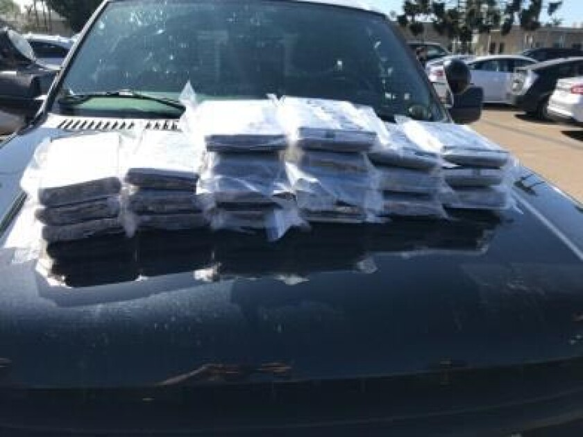 Authorities seized 44 pounds of powdered fentanyl from a vehicle on Interstate 905 in San Diego.