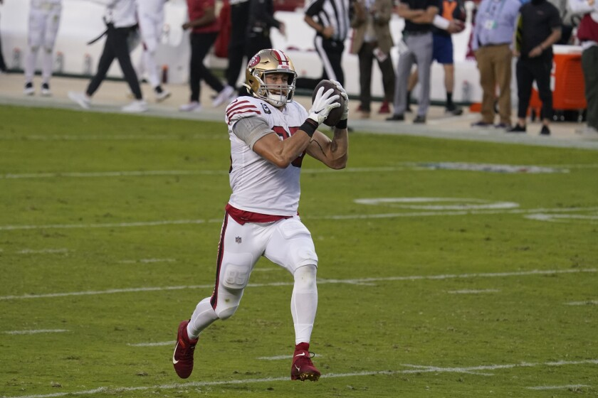 San Francisco 49ers tight end George Kittle runs toward the end zone for a touchdown against the Rams.