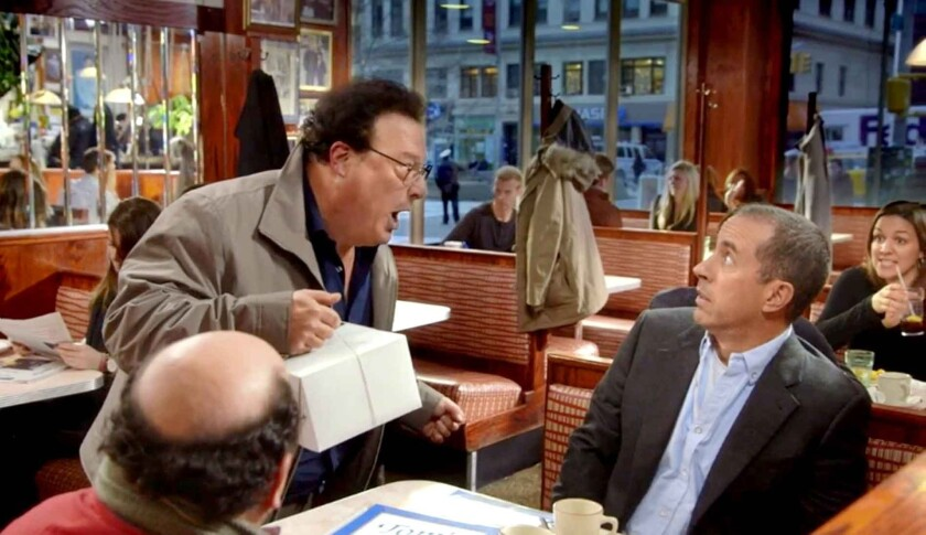 "The much-speculated-upon ""secret"" Seinfeld Super Bowl project revealed itself to be both a mini cast reunion and a commercial for Jerry Seinfeld's web series ""Comedians in Cars Getting Coffee."" Jerry Seinfeld, Jason Alexander and Wayne Knight are seen in this screen shot from the latest episode, ""The Over-Cheer."""