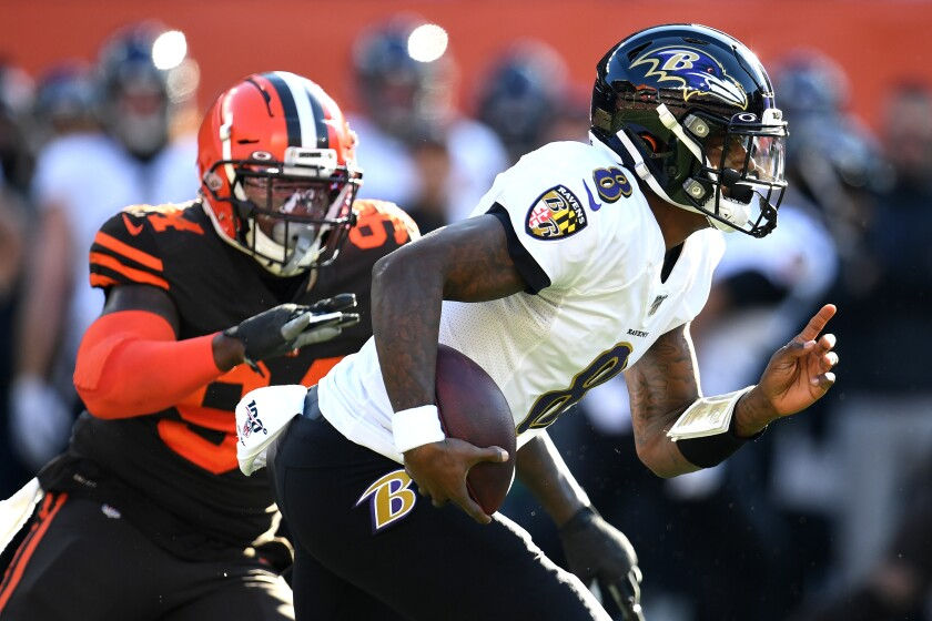 Baltimore Ravens quarterback Lamar Jackson runs the ball against the Cleveland Browns on Sunday at FirstEnergy Stadium.