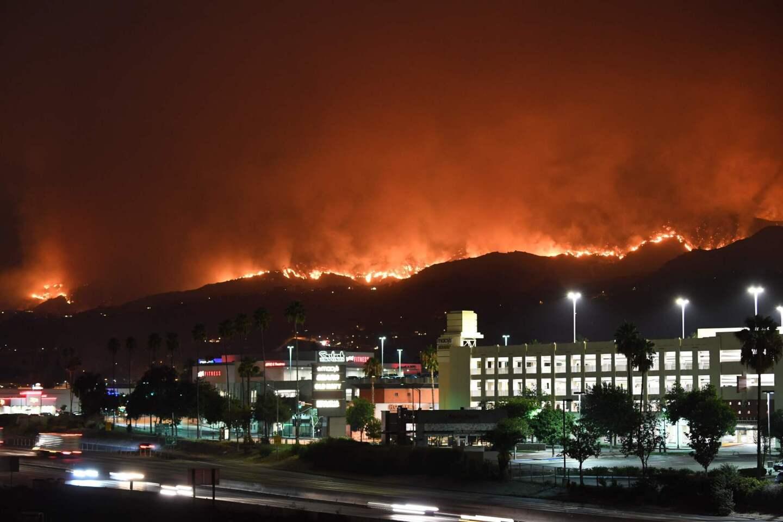 The La Tuna fire burns in the hills above Burbank early Saturday.