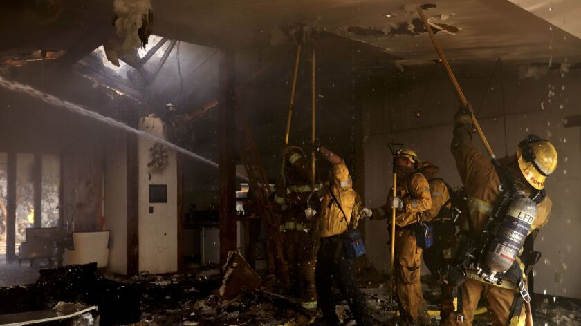 BEL AIR - DECEMBER 6, 2017 -- Firefighters try and save a home from the Skirball fire along Linda Fl
