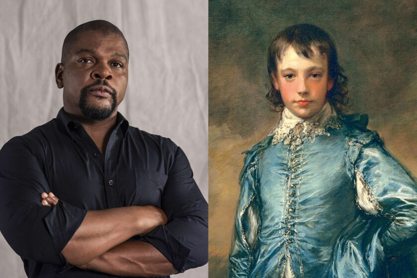 """Artist Kehinde Wiley stands with arms crossed; Thomas Gainsborough's painting """"The Blue Boy"""""""