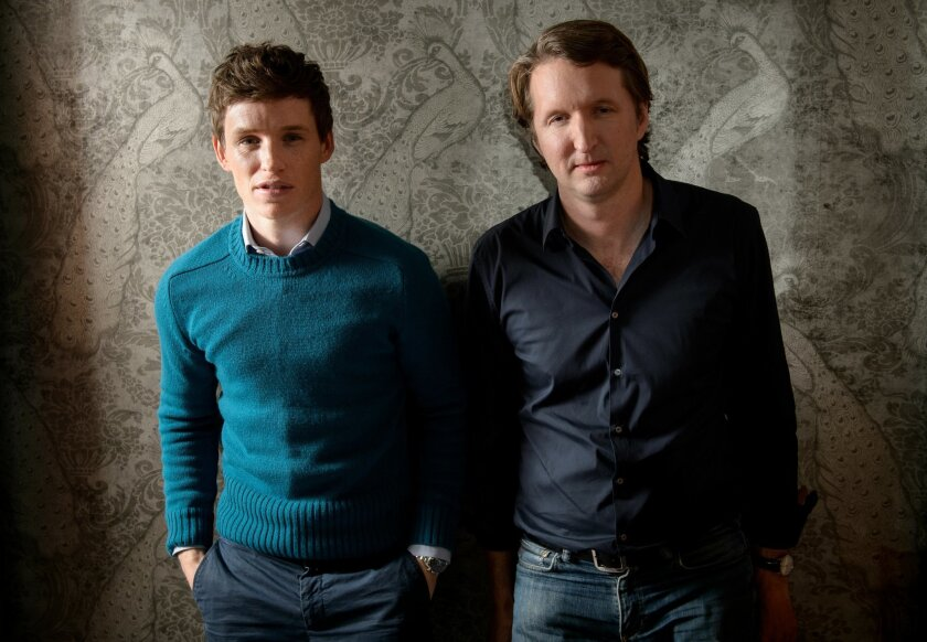 """FILE - In this Oct. 25, 2015 file photo, British director Tom Hooper, right, and British actor Eddie Redmayne pose for a portrait in promotion for """"The Danish Girl"""" in London. (Photo by Jonathan Short/Invision/AP, File)"""