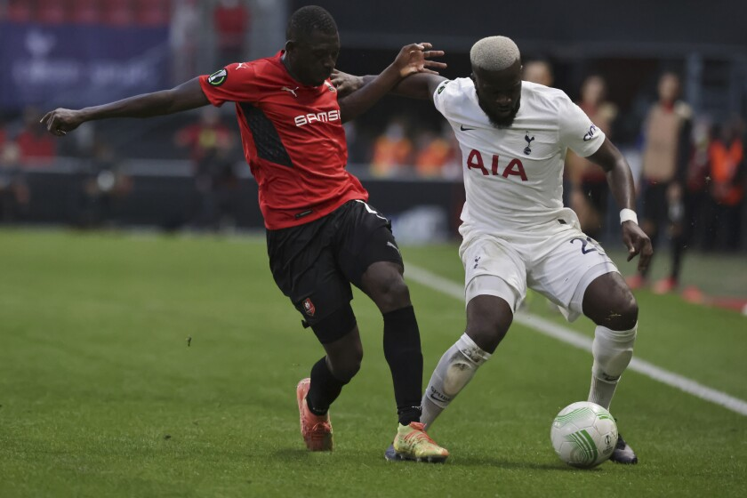 Rennes' Hamari Traore, left, challenges the ball to Tottenham's Tanguy Ndombele during the Europa Conference League Group G soccer match Rennes against Tottenham at the Roazhon Park stadium in Rennes, western France, Thursday, Sept.16, 2021. (AP Photo/Jeremias Gonzalez)