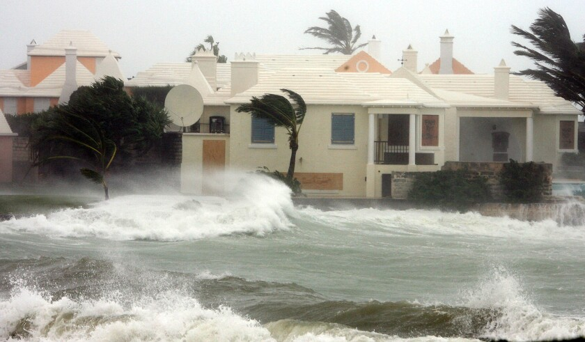 HOUSE HIT BY HIGH WAVES