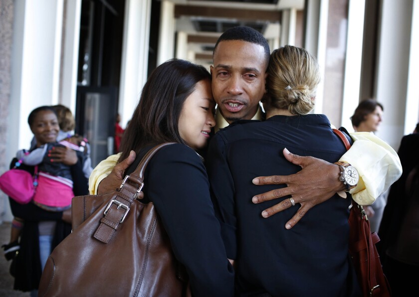 Obie Anthony hugs members of his legal team during a news conference. Last month, Los Angeles agreed to an $8-million settlement for Anthony, who was declared factually innocent by a judge after spending 17 years in prison.