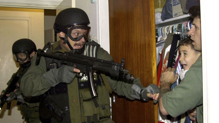 This image of a frightened Elian Gonzalez being held as federal agents raided his relatives' Miami home earned Alan Diaz a Pulitzer prize.