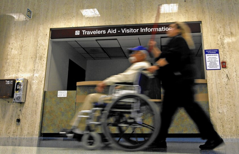 A traveler in a wheelchair at LAX