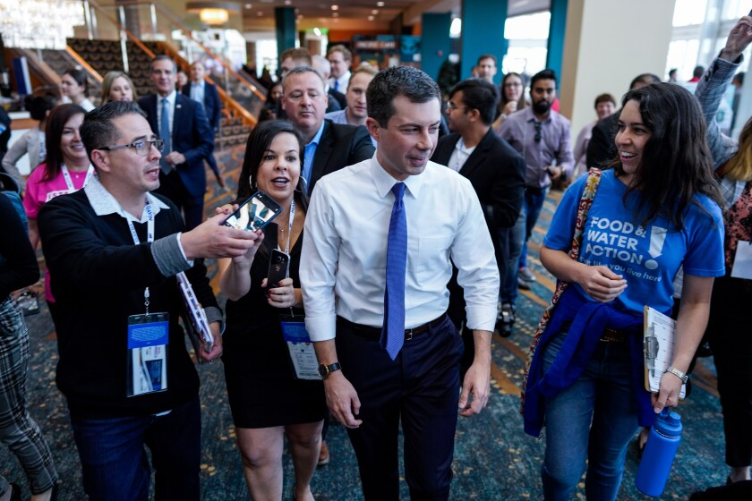 South Bend, Ind., Mayor Pete Buttigieg is surrounded by delegates and well wishers Nov. 16 in Long Beach.