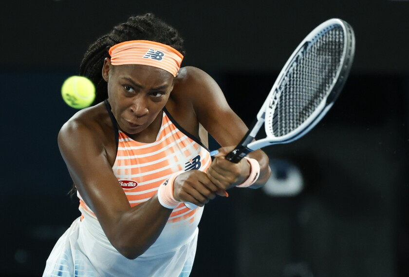 United States' Coco Gauff makes a backhand return to Ukraine's Elina Svitolina during their second round match at the Australian Open tennis championship in Melbourne, Australia, Thursday, Feb. 11, 2021.(AP Photo/Rick Rycroft))