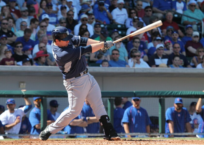 Padres second baseman Jedd Gyorko doubles to center field in the fifth inning against the Chicago Cubs.