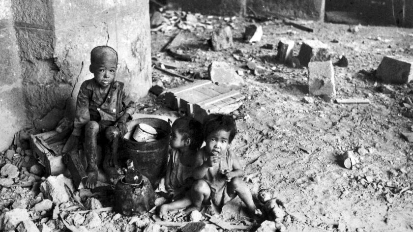 Children in Manila in 1945, in the aftermath of a protracted battle and other horrors.