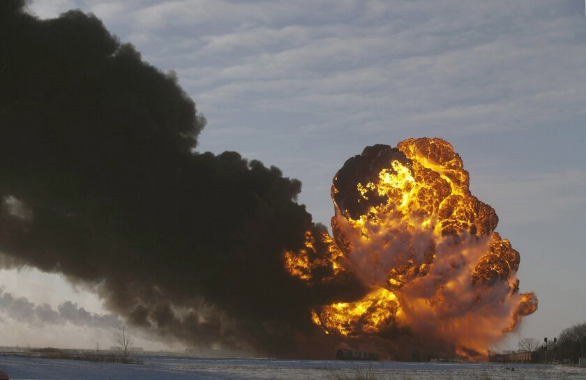 FILE - In this Dec. 30, 2013 file photo, a fireball goes up at the site of an oil train derailment near Casselton, N.D.  A fire engulfed tank cars loaded with oil on a Burlington Northern Santa Fe train after a collision about a mile from Casselton. No one was injured, but more than 2,000 residents