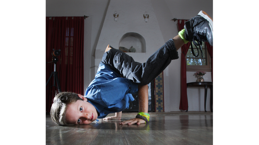 Jonah Jacobson dances at his home in Glendale. He recently held a fundraiser, where he showed off his break-dancing movies, and raised $800 for Ascencia, Glendale's largest homeless services provider.