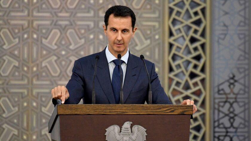 Syrian President Bashar Assad speaks to Syrian diplomats in Damascus on Aug. 20.