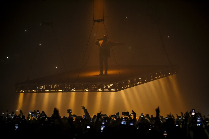 Kanye West performs on a floating stageat the Forum in Inglewood on Oct. 25. West ended his Thursday performance at the Forum mid-set after complaining of throat problems.