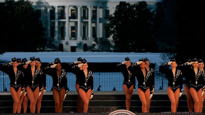 The Rockettes perform with the White House in the background in Washington in 2005.