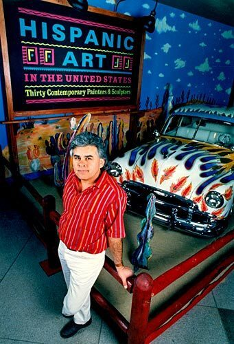 """Gilbert """"Magú"""" Luján in 1989 with his hand-painted lowrider """"Our Family Car,"""" part of an exhibit at the Los Angeles County Museum of Art. See full story"""