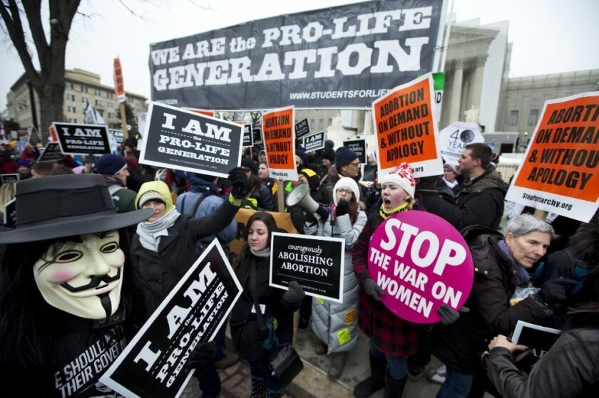 Abortion-rights activists and antiabortion protesters outside the Supreme Court in Washington in January during demonstrations that coincided with the 40th anniversary of the Roe vs. Wade decision legalizing abortion.