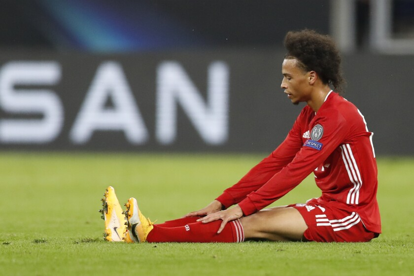 FILE - In this Thursday, Sept. 24, 2020 file photo, Bayern's Leroy Sane sits on the pitch during the UEFA Super Cup soccer match between Bayern Munich and Sevilla at the Puskas Arena in Budapest, Hungary. Sane is back in full training with the Bayern Munich team after recovering from his knee injury. He took part in sprint and game drills with the rest of the squad on Thursday, Oct. 22. (AP Photo/Laszlo Balogh, file)