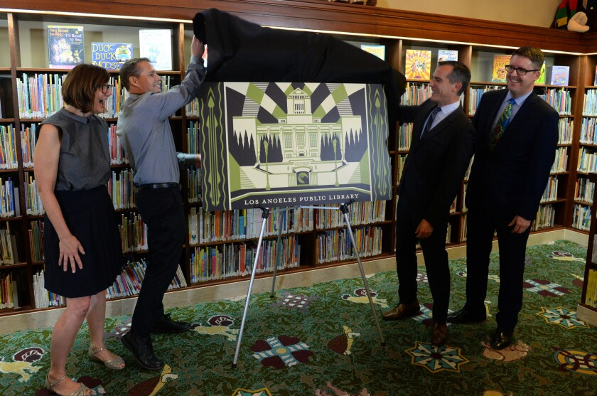 Unveiling Los Angeles' first artist-designed, limited-edition library card are (from left) Department of Cultural Affairs General Manager Danielle Brazell, artist Shepard Fairey, Mayor Eric Garcetti and City Librarian John F. Szabo.