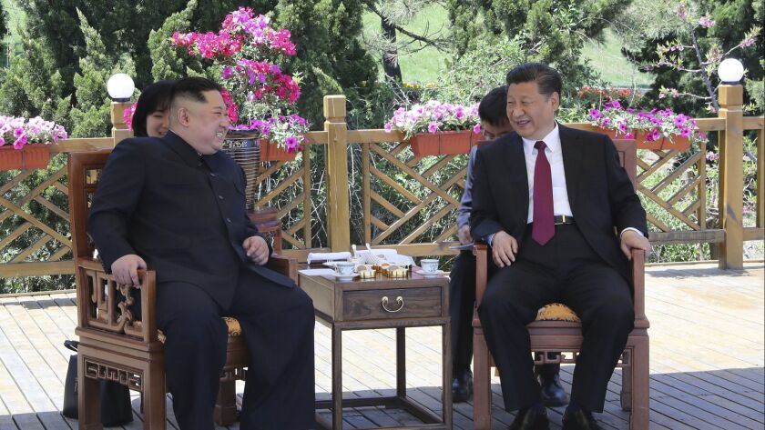 Chinese President Xi Jinping, right, speaks to North Korean leader Kim Jong Un in Dalian in northeastern China's Liaoning province. The photo was taken either on May 7, 2018, or the next day.