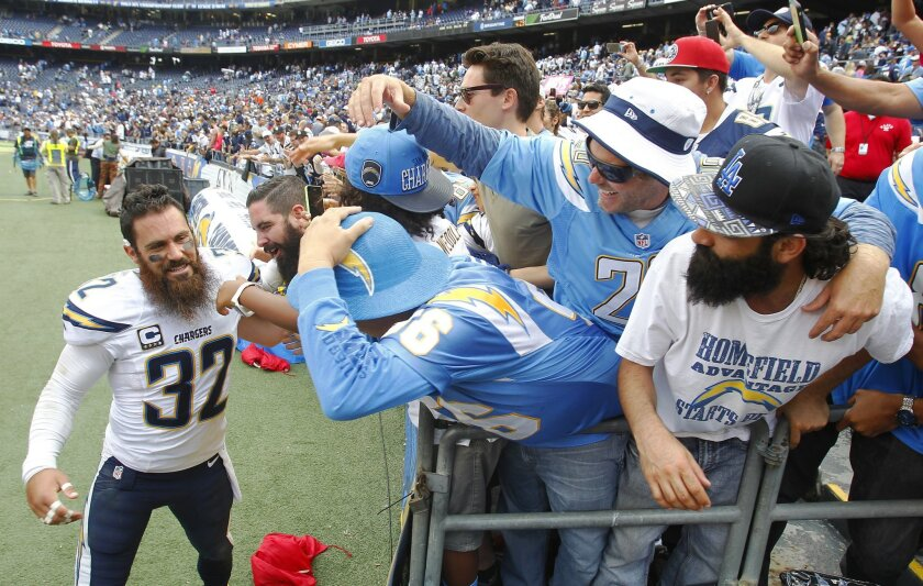 Chargers Eric Weddle celebrates with fans after a 30-27 win over the Browns.