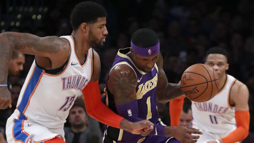 LOS ANGELES, CALIF. - JAN. 2, 2019. Lakers guard Kentavious Caldwell-Pope steals the ball from Thun