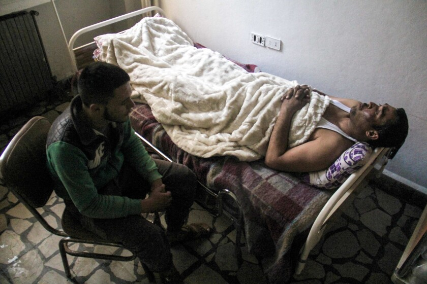 Hassan Youssef, 40, a victim of the suspected toxic gas attack in Khan Sheikhoun, receives medical care in a hospital in the nearby northwestern Syrian city of Idlib.