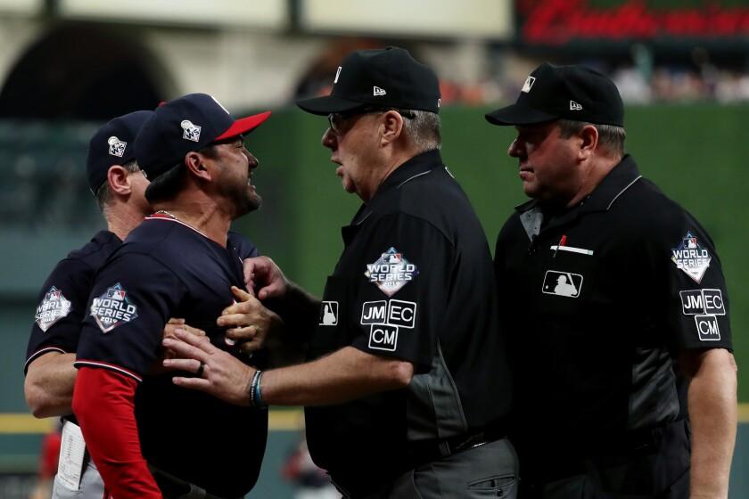 Washington Nationals manager Dave Martinez argues with home plate umpire Sam Holbrook.