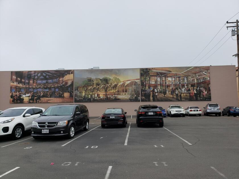 A panorama with renderings of The Conrad Performing Arts Center on the back side of a building at 1111 Prospect St., La Jolla.