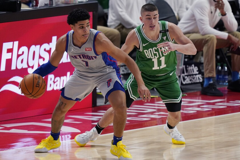 Detroit Pistons guard Killian Hayes (7) looks to pass the ball as Boston Celtics guard Payton Pritchard (11) defends during the first half of an NBA basketball game Friday, Jan. 1, 2021, in Detroit. (AP Photo/Carlos Osorio)