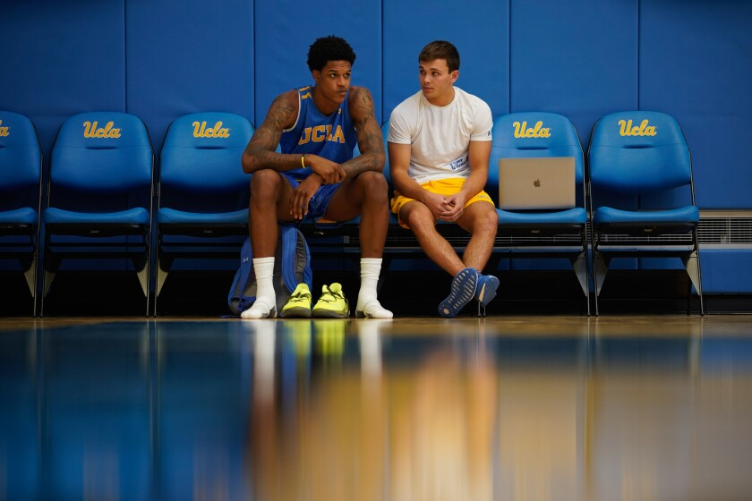 UCLA's Shareef O'Neal, left,chats on the sidelines before practice at the Mo Ostin Basketball Center on Thursday in Westwood.