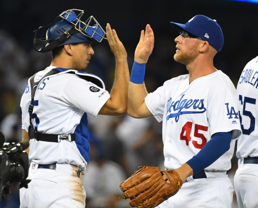 LOS ANGELES, CA - JULY 20: Matt Beaty #45 of the Los Angeles Dodgers is congratulated by Austin Barnes #15 of the Los Angeles Dodgers after the final out of the ninth inning of the game against the Miami Marlins at Dodger Stadium on July 20, 2019 in Los Angeles, California. (Photo by Jayne Kamin-Oncea/Getty Images) ** OUTS - ELSENT, FPG, CM - OUTS * NM, PH, VA if sourced by CT, LA or MoD **