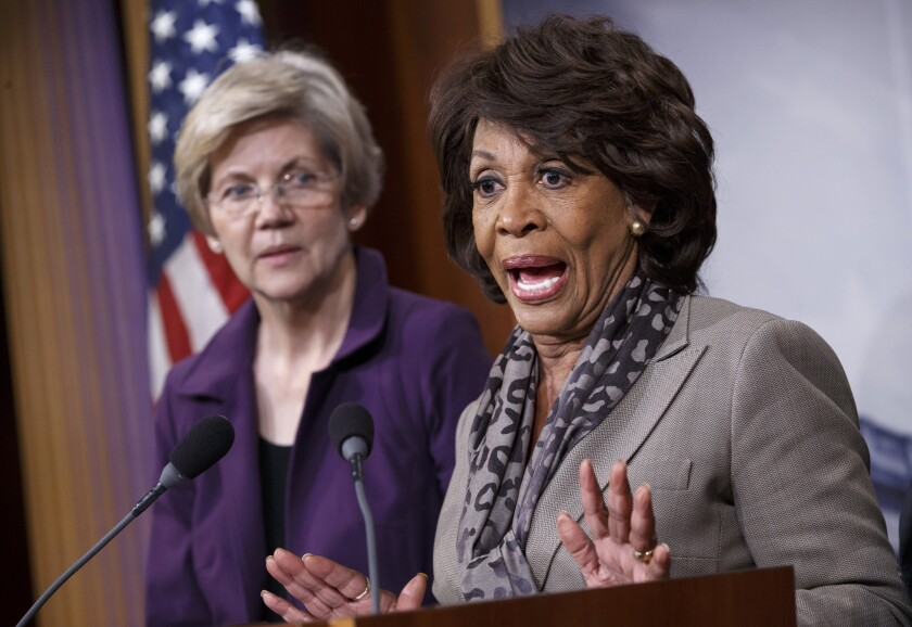 Sen. Elizabeth Warren (D-Mass.), left, and Rep. Maxine Waters (D-Los Angeles) appear at a December news conference. The two have been leading efforts to stop Republicans from making changes to the Dodd-Frank financial reform law.