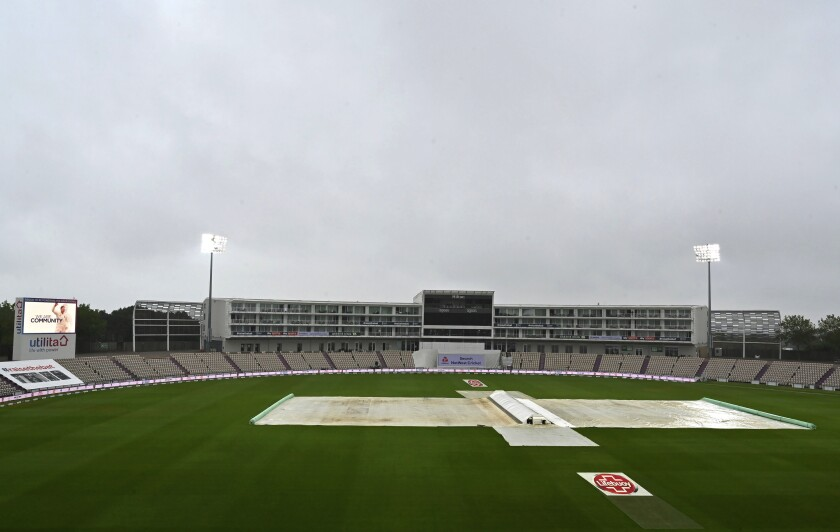 The pitch area is seen covered as rain delayed start of the third day of the second cricket Test match between England and Pakistan, at the Ageas Bowl in Southampton, England, Saturday, Aug. 15, 2020. (Glyn Kirk/Pool via AP)