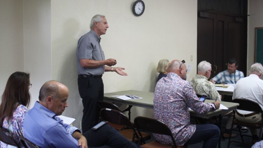 Phil Merten speaks on behalf of residents opposed to the project.
