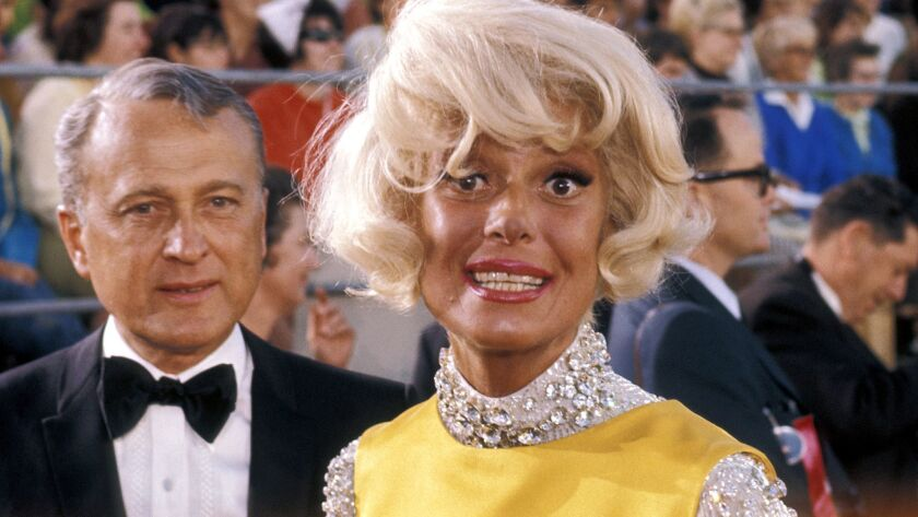 Carol Channing, arriving with Charles Lowe to the 1968 Academy Awards at the Dorothy Chandler Pavilion in Los Angeles.