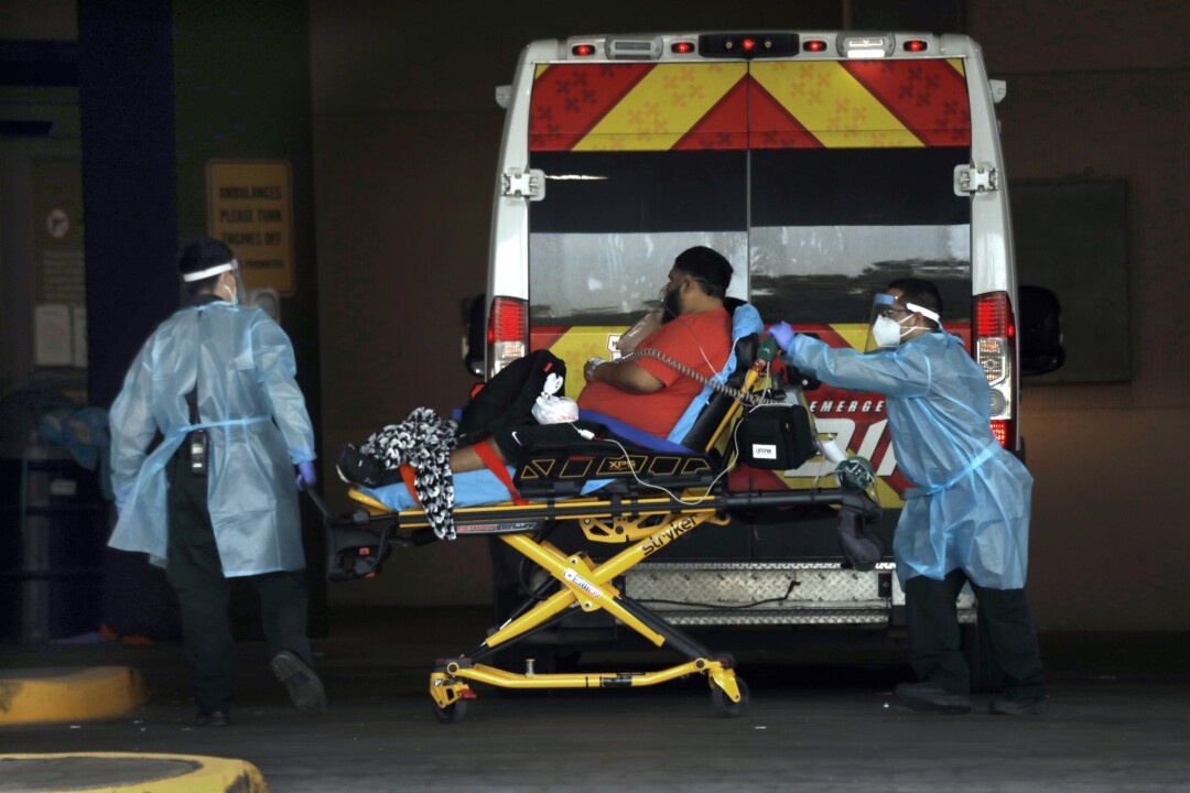 A man is transported to a hospital on a gurney in McAllen, Texas.