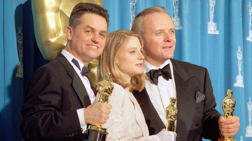"irector Jonathan Demme, from left, actress Jodie Foster and actor Anthony Hopkins hold their Oscars for their work on ""Silence of the Lambs,"" at the Academy Awards in Los Angeles on May 31, 1992."