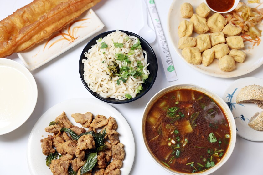 Soy bean milk, baked turnip cake with pork, special crispy chicken, twisted fried dough, spicy beef noodle soup and tofu.