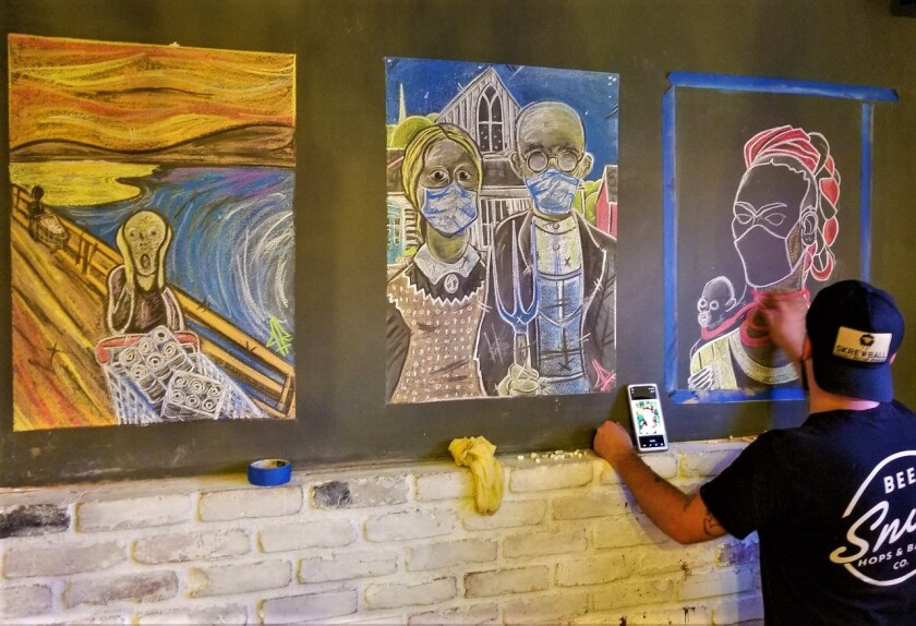 Justin Rutland creates COVID-19-related art as decor at Giardino restaurant in Lemon Grove.