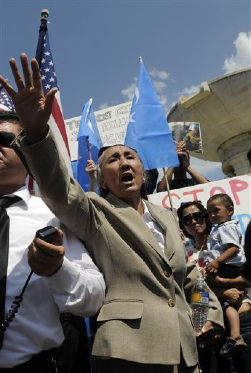 President of the Uighur American Association Rebiya Kadeer speaks at a Uighur protest at Dupont Circle in Washington on Tuesday, July 7, 2009. The exiled Uighur leader accused by China of inciting ethnic violence says the Chinese government is responsible for the rising tensions. Chinese authorities have accused Kadeer of inciting violence between Muslim Uighurs and ethnic Han Chinese, in which at least 156 people have been killed. The riots broke out Sunday in China's Xinjiang region. (AP Photo/Stephen J. Boitano)